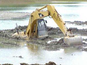bulldozer-stuck-in-the-mud-300x224.jpg